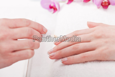 professional nail technician at a manicure