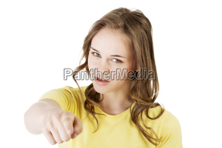 young beautiful caucasian woman pointing on