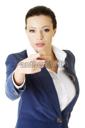 young beautiful caucasian business woman pointing