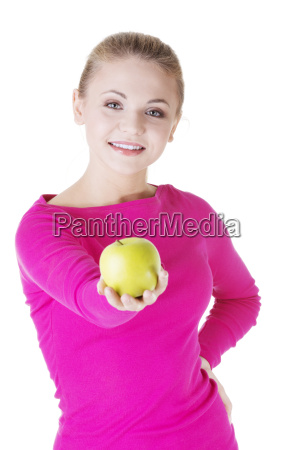 young woman holding green fresh apple