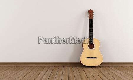 gitara akustyczna w pustym pokoju