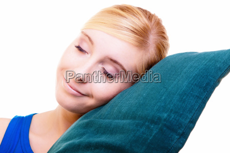 sleepy blond girl with green pillow