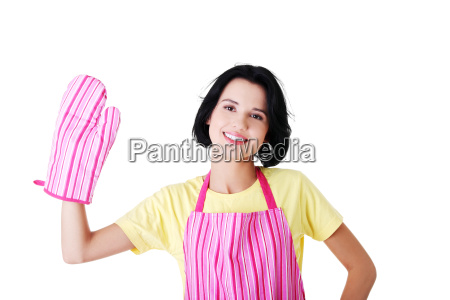 young housewife in kitchen apron and
