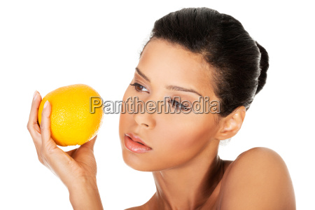 young beautiful spa woman with orange