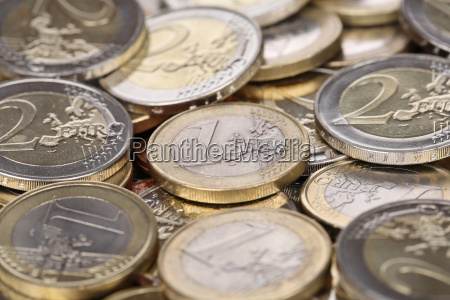 one and two euro coins from