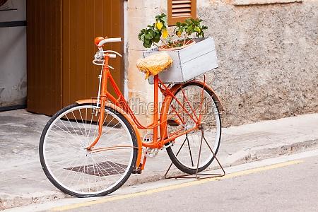 rower damski w orange z kwiatami