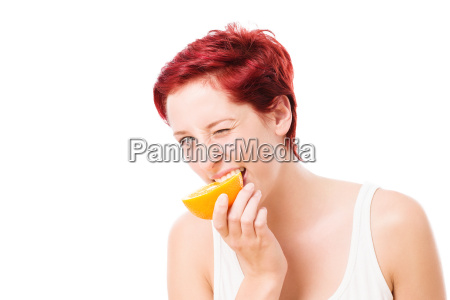 young woman bite in orange