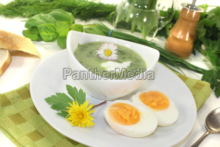 herb soup with eggs and a