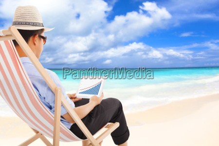 businessman sitting on beach chairs and