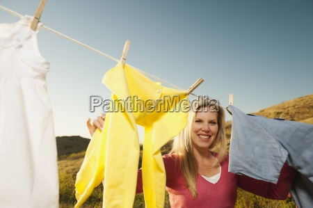 clothesline laundry woman hanging in a