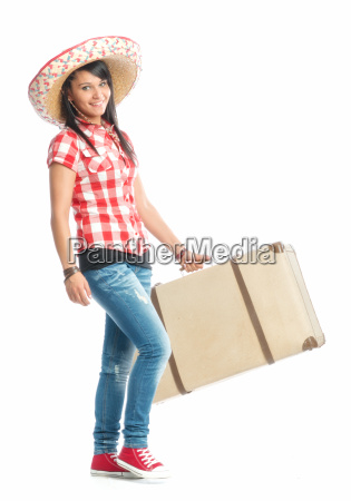 young girl with sombrero carrying a