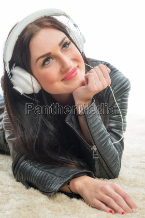 bream woman with headset enjoys music