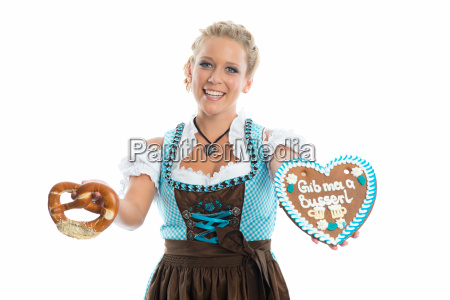 bavarian girl with gingerbread heart and