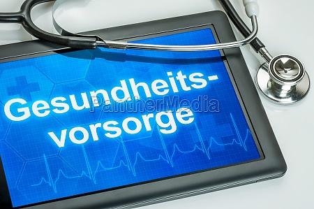 tablet z tekstem opieka zdrowotna na