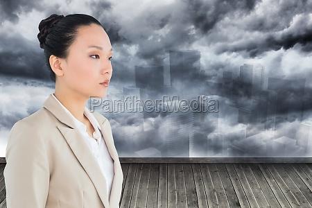 composite obraz unsmiling asian businesswoman