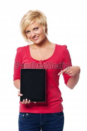 smiling blonde woman pointing at screen