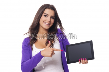 smiling woman pointing at screen of