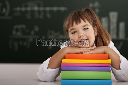 cute little girl with her books