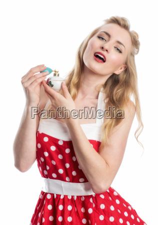 woman with perfume atomizer