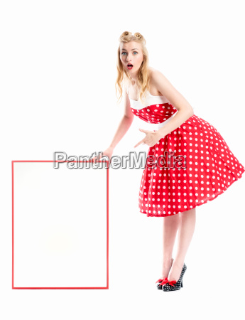 a woman in rockabilly style holding