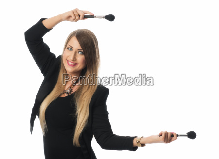 make up artist with cosmetic brushes