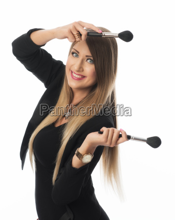 make up artist with cosmetic brush
