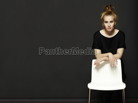young woman and white chair