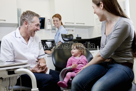 a male dentist with a little
