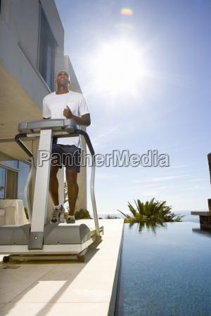 man on running machine by swimming
