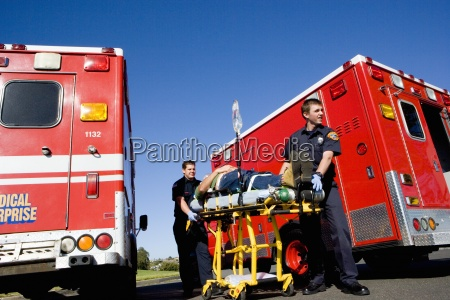 paramedics with man on stretcher by