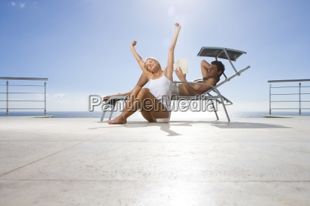 young woman stretching by man on