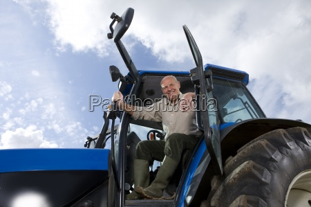 portrait of farmer in tractor
