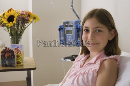 girl 9 11 sitting in hospital