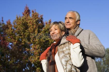 senior couple standing in garden in