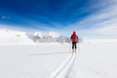 mountaineer walking on a glacier during