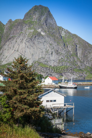 typical norwegian fishing village with traditional