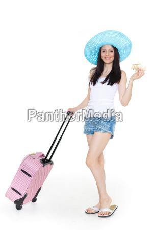 mloda kobieta z walizka