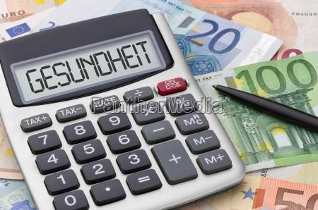 kalkulator z banknotami zdrowie