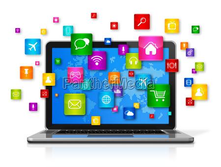 komputer przenosny i ikony aplikacji latajacych