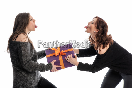 2 girlfriends fighting over a gift