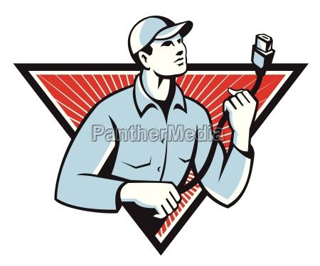 pracownik technik posiadajacy przewod hdmi retro