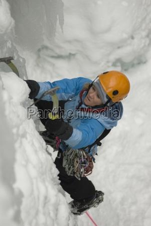 a professional female climber ice climbing