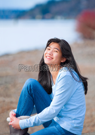 young teen girl in blue shirt
