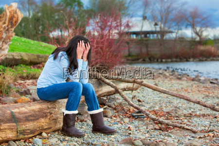 sad young teen girl sitting on