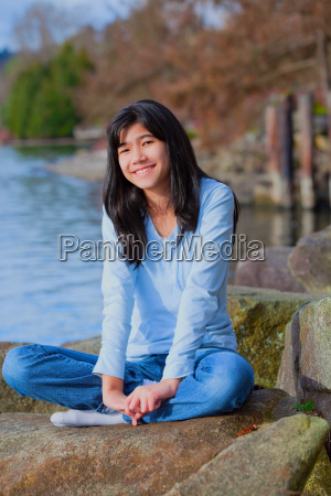 young teen girl relaxing on large