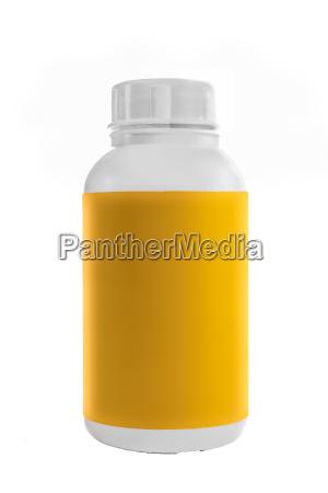 bialy plastikowy pojemnik z zolta etykieta