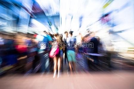 people climb a ferrymotion blur