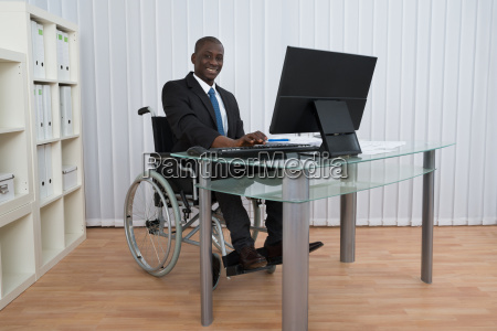 businessman working in office sitting on