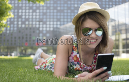 pretty girl using her phone while
