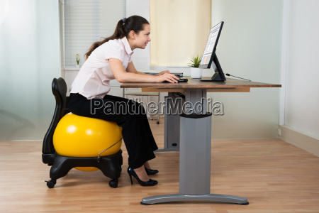 businesswoman bending while sitting on fitness